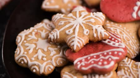 fondant : Baked Christmas cookies on rustic dark background. Stock Footage