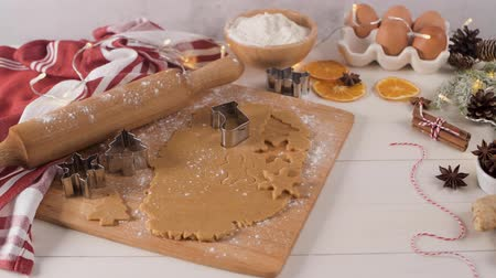 countertop : Raw dough for christmas cookies and cookie cutters on kitchen countertop.