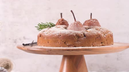 домовой : Delicious cake with pear, ginger and cinnamon on a dark kitchen counter.