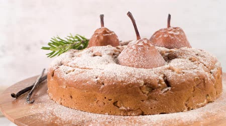 pears : Delicious cake with pear, ginger and cinnamon on a dark kitchen counter.