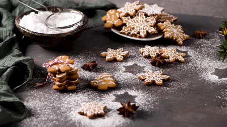 сладость : Christmas cookies on kitchen countertop with festive decorations. Стоковые видеозаписи