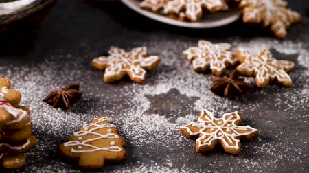 anis : Christmas cookies on kitchen countertop with festive decorations. Vidéos Libres De Droits