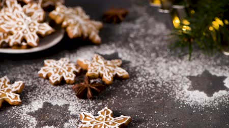 édesség : Christmas cookies on kitchen countertop with festive decorations. Stock mozgókép