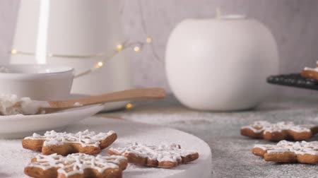 fırınlama : Christmas cookies on kitchen countertop with festive decorations. Stok Video