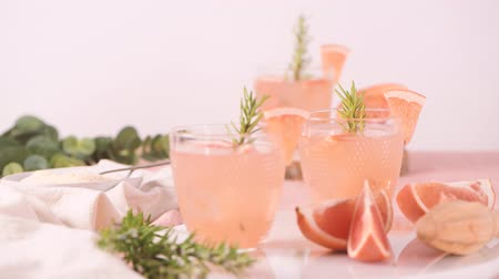 aperitief : Grapefruit juice with rosemary in glasses on the table. Refreshing summer cocktail.