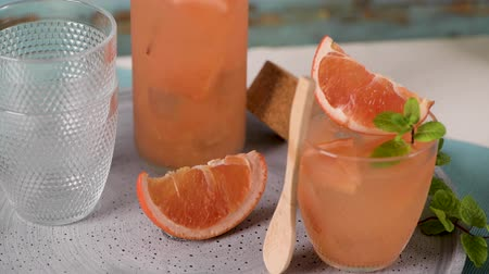 cold drinks : Grapefruit juice with rosemary in glasses on the table. Refreshing summer cocktail.