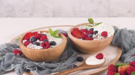 antioksidan : Yogurt with Chia seeds and fresh Strawberries, Raspberries, and Blueberries. Concept of Healthy Eating.