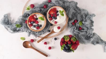 Yogurt with Chia seeds and fresh Strawberries, Raspberries, and Blueberries. Concept of Healthy Eating.