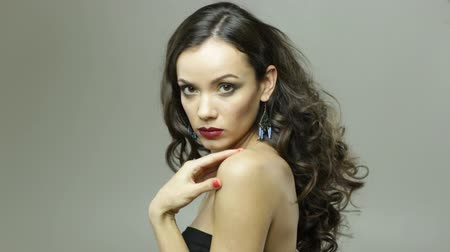 Sensual pretty brunette with red lips