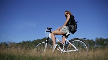 Young woman with bicycle Stock mozgókép