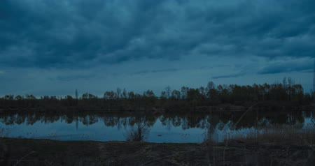 Gloomy timelapse of blue hour on lake