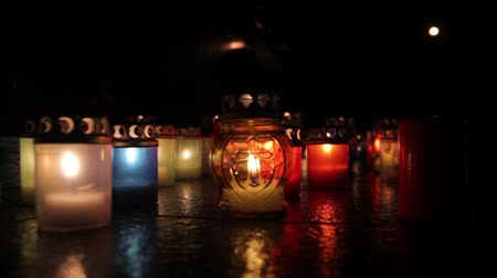 traditional ceremony : Beautiful oil candles at night Stock Footage