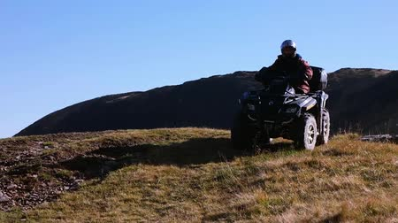 atv : Man driving a quad drive bike ATV on a mountain pasture Stock Footage