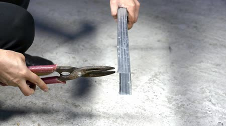 Worker cut with scissors for metal profile