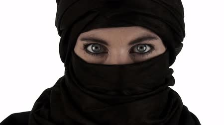 eye : Close up on a woman wearing a chador with a white background