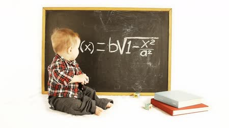 vzorec : Adorable baby boy in front of a blackboard with a scientific formula