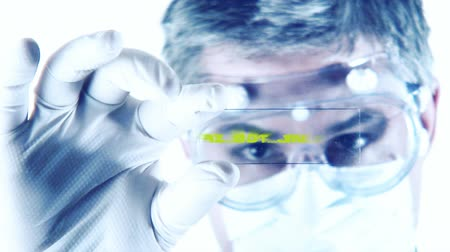 impressão digital : male scientist studying genetic digital samples Stock Footage