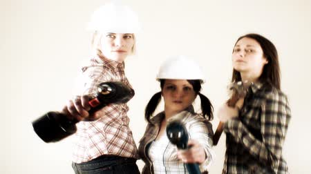 broca : 3 girls in the seventies style of Charlie Angels ready for some serious home improvement action…  Stock Footage