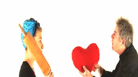 loutka : video of a couple at Valentine day. He offers her his heart and she offers him a hit of rolling pin!  This video can be used for many concepts related to life as a couple type of thing and of course for Valentine day celebration  in a funny way. Dostupné videozáznamy