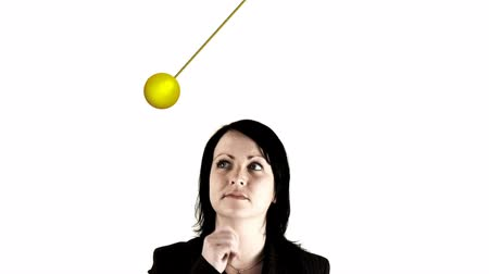 indecisiveness : corporate young professional facing choices in front of a pendulum. That might be Yes or that might be No