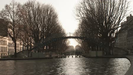 paříž : Bridge over the Saint Martin canal in Paris during winter. Pedestrian crossing and seagulls flying by.