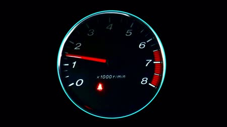 wyscigi : HD video of Rpm dashboard meter in action over a plain black background .  This video can be used for numerous concepts in relation to speed, power, data transit, racing