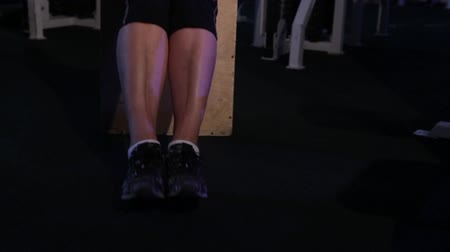 positive ageing : Flexion of the feets in a sitting position.An older woman practicing joint gymnastics.Copy space Stock Footage