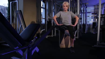 move well : Extension of the legs at the knees in a sitting position.An older woman practicing joint gymnastics.Copy space