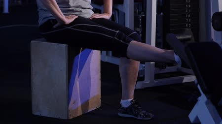 move well : Extension of the legs at the knees in a sitting position.An older woman practicing joint gymnastics.Copy space.side view.close-up Stock Footage