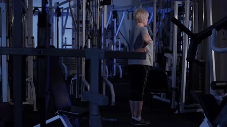 move well : An older woman doing a sock lift.joint gymnastics.Copy space.side view Stock Footage