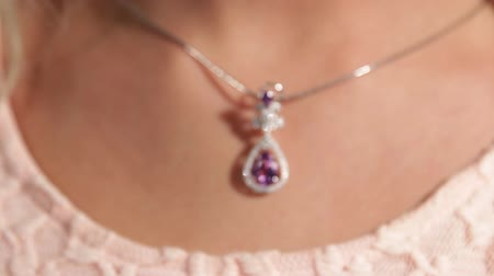 кулон : Silver pendant with a magenta diamond.Pretty girls neck.Shallow depth of field.Jewellery