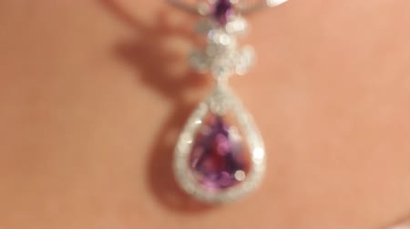 кулон : Very closeup of silver pendant with a magenta diamond on the beautiful womans neck.Jewellery.Shallow depth of field