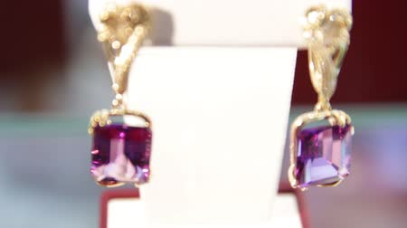 pedra preciosa : Jewellery.Close-up of the magenta diamond earrings in the jewelry store.Shallow depth of field