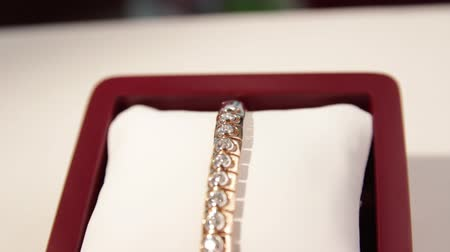 браслет : Jewellery.A close-up of a diamond gold bracelet in a box.Jewelry store.Shallow depth of field