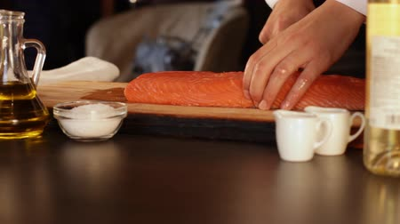 filet : The chef cuts a big piece of raw salmon fillet.High protein foods