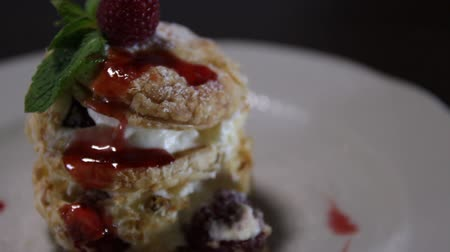 napoleon : Millefeuille dessert decorated with raspberries on a white plate.Napoleon cake.Copy space.close-up