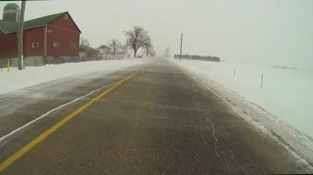 országúti : Point of View Drive (POV) in blowing snow causes whiteouts Stock mozgókép