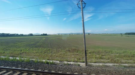 point of view pov : Restful countryside view from a moving train