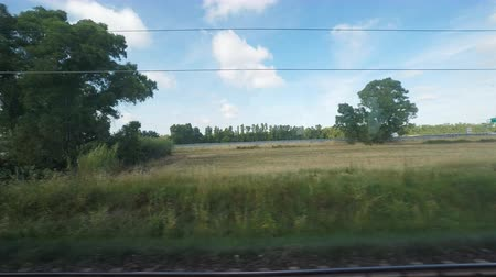 point of view pov : Point of view of peaceful countryside from a train