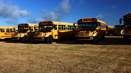 porta : 4K UltraHD Motion controlled timelapse pan of line of schoolbuses