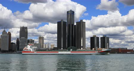 mi : Freighter crosses the Detroit skyline Stock Footage
