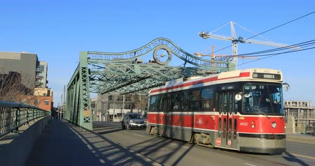 truss : Red transit vehicle on the Queen Street Bridge in Toronto 4K