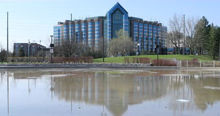 hilton : Hilton Hotel and reflecting pool in Markham, Canada 4K Stock Footage