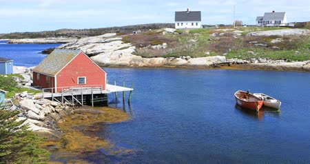 fishing village : Scene of colorful buildings at Peggys Cove in Nova Scotia 4K