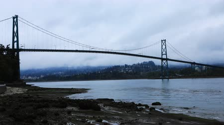 ingiliz columbia : Timelapse View of Lions Gate Bridge in Vancouver, Canada 4K Stok Video