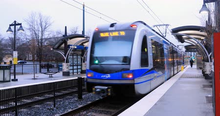 electric : Rapid Transit leaving station in Charlotte, North Carolina 4K