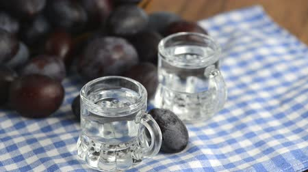 hz : plums rolling between two short glasses with liquor inside