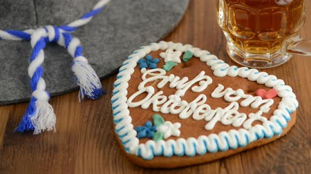 keksz : putting hat and beer glass on table with a Oktoberfest Gingerbread Cookie with bavarian hat. Typical Oktoberfest in Munich.