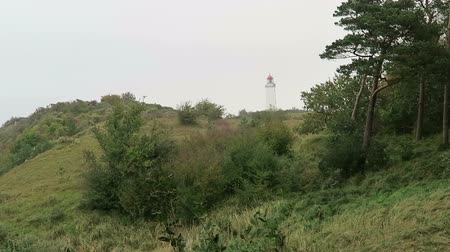thornbush : People hiking to Lighthouse on Dornbusch Hill at Hiddensee Isle in Germany. Autumn time.