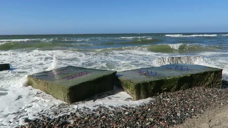 baltské moře : beach of baltic sea coast at Wustrow. old bunker of second world was in waves.